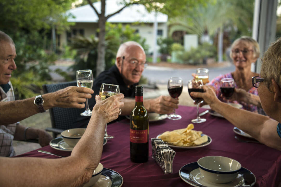 Greenfields residents enjoying dinner and drinks together